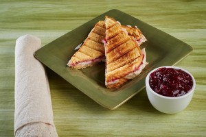 turkey panini on green plate