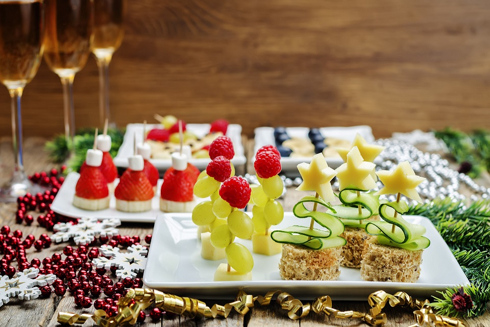 Assortment of New Year's snacks and a glass of champagne. toning. selective focus
