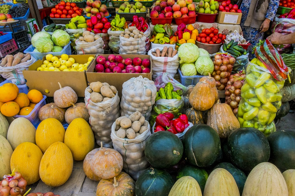 Variety of fresh fruit and vegetables at market