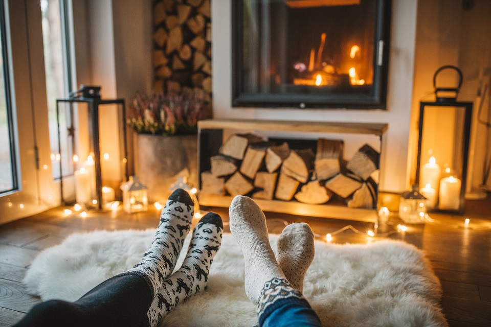 Couple in front of fireplace.