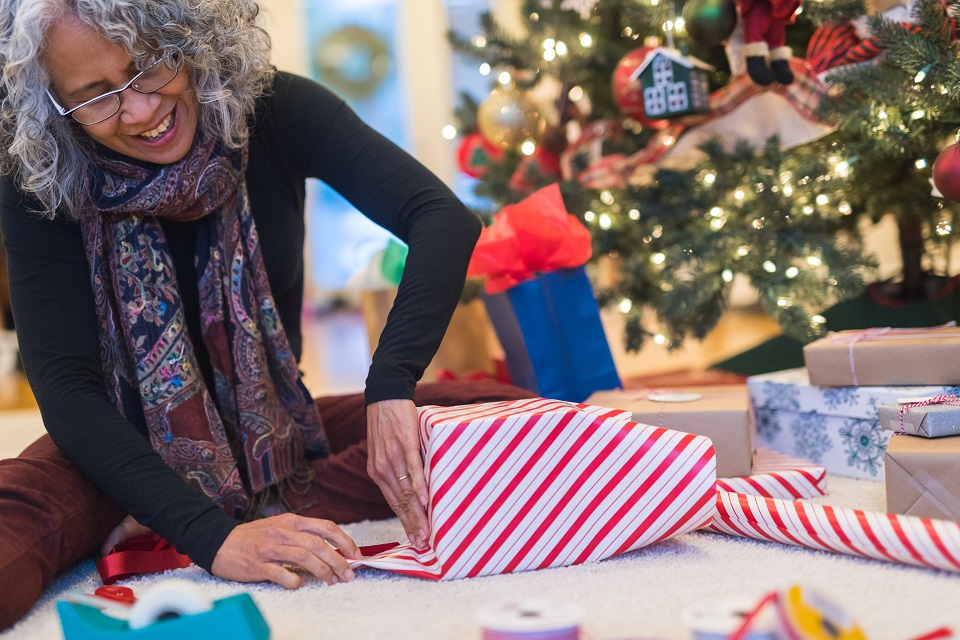 Woman wrapping holiday package