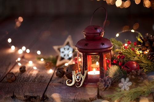 Wooden table with holiday lights and ornaments