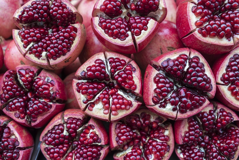 Close up of pomegranate halves on a table