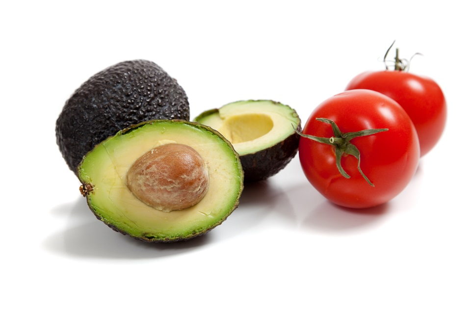 Avocados and tomatoes on a white background